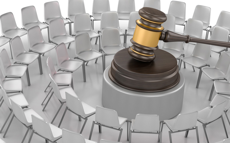 A gavel in the middle of a room symbolizing trial presentation